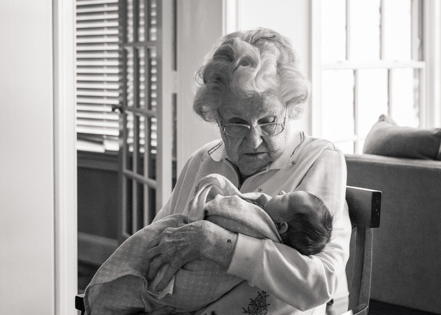 Great grandmother holding newborn great granddaughter