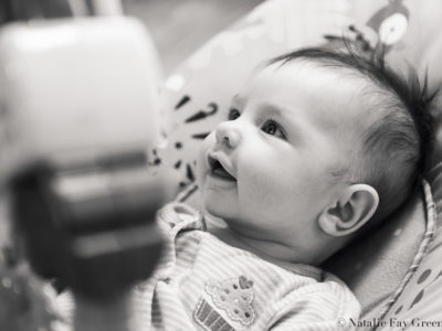 baby laughing in bouncy seat