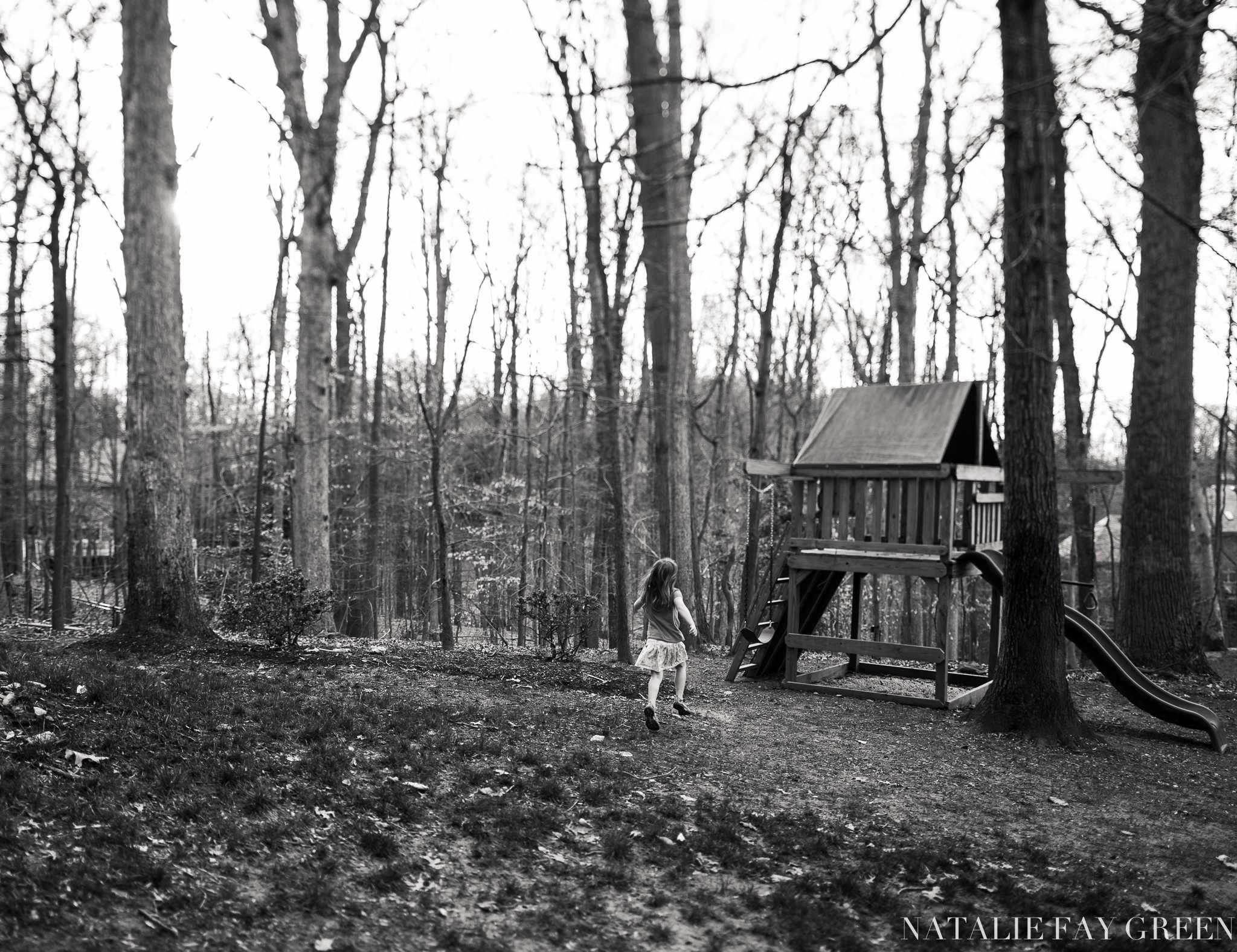 Girl running towards swings