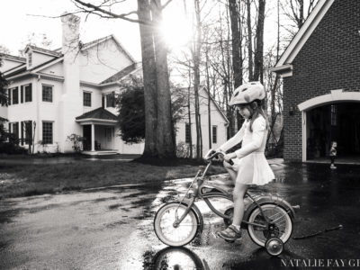 girl wearing leotard and riding bike - driveway - beautiful light