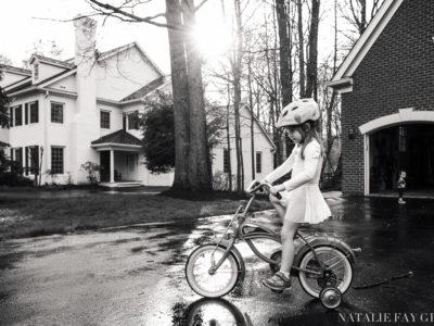 girl wearing leotard and riding bike - driveway - beautiful light