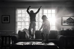 Brother and Sister jumping sofa after school