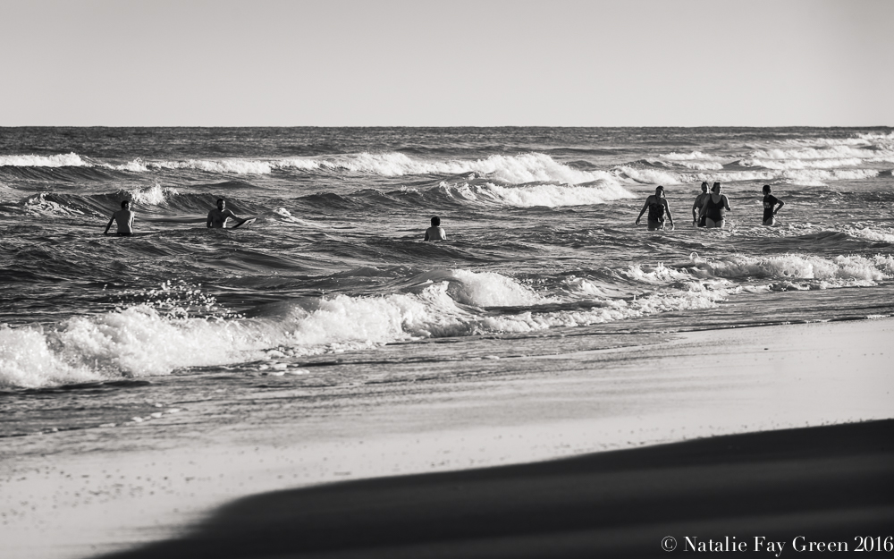 Surfers and Swimmers on the beach in Corolla North Carolina