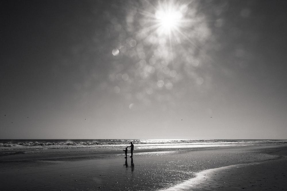Dad and son surf fishing at dawn