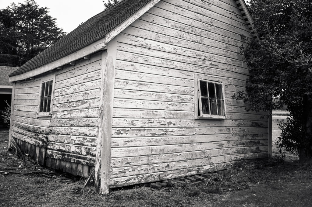 old smokehouse in danger of falling down in Cambridge Maryland