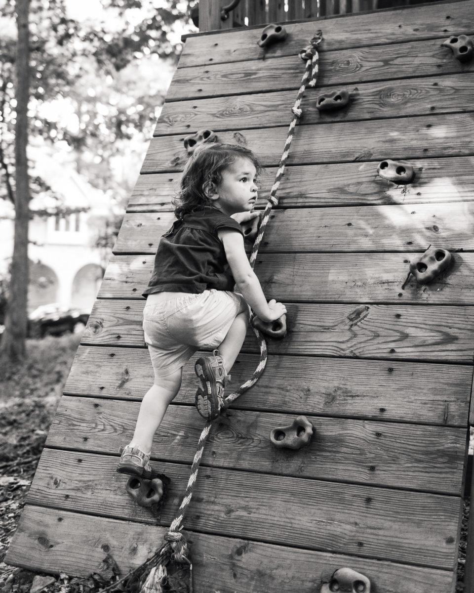 toddler climbing rock wall