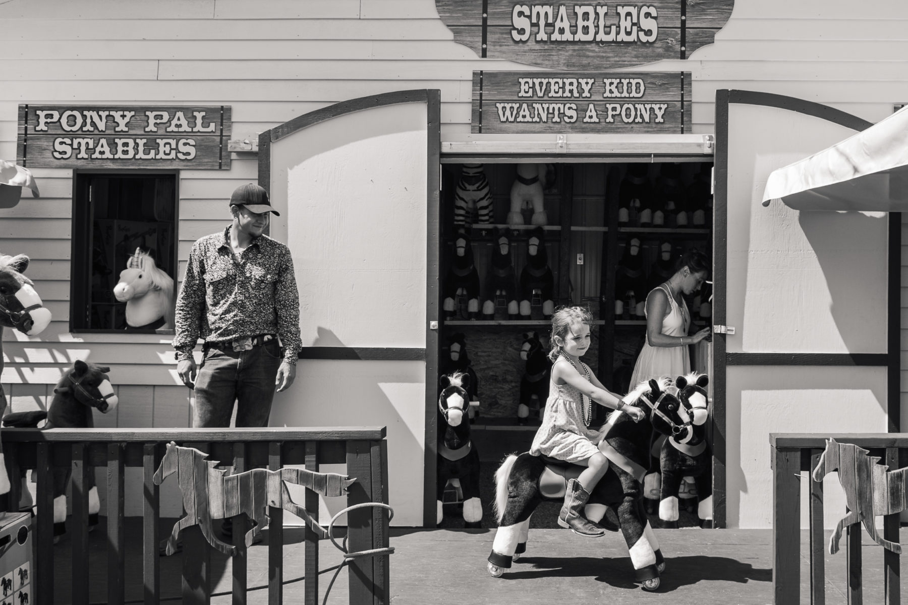 little girl riding a toy pony at Cheyenne Frontier Days