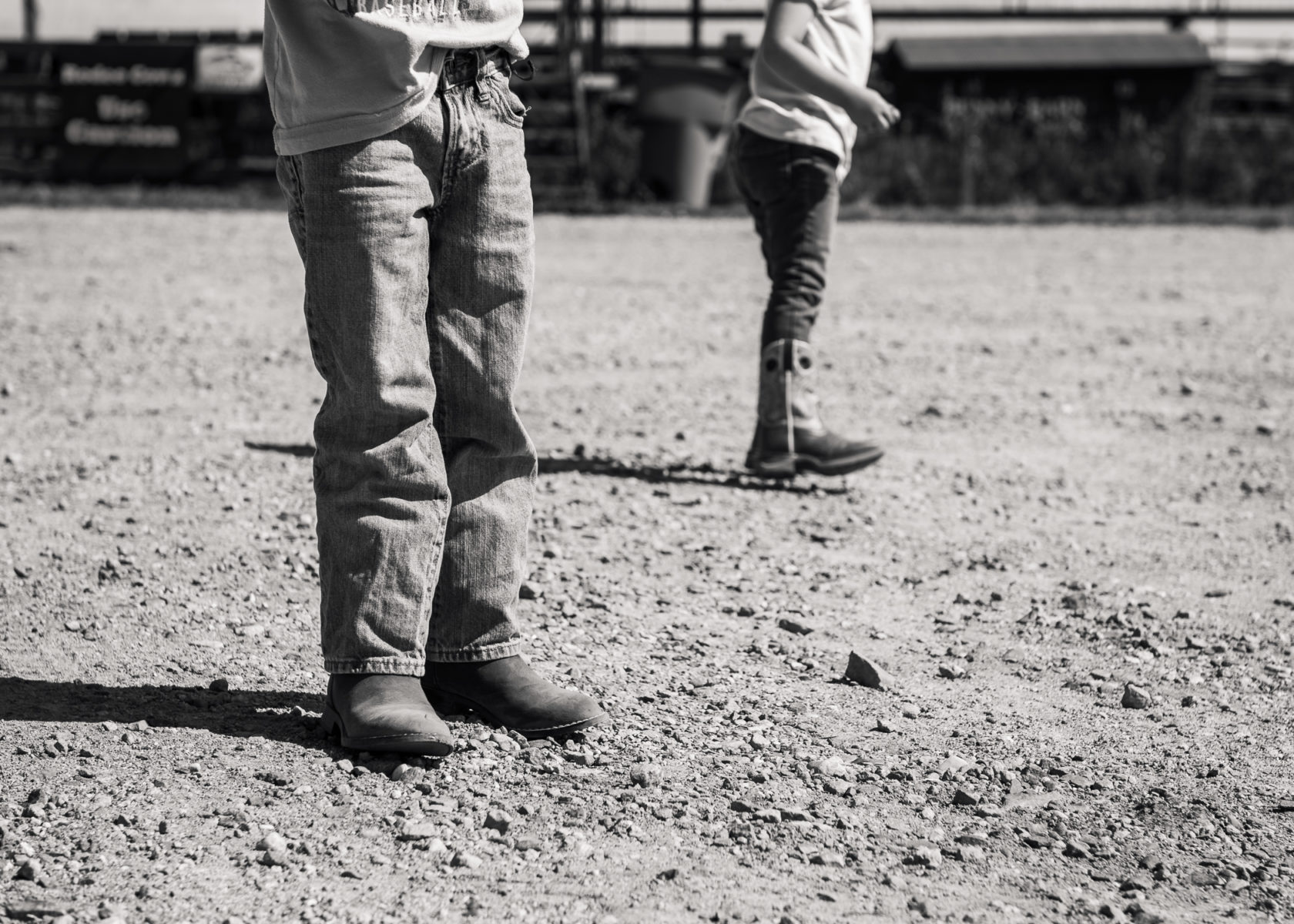 children wearing new boots on a farm