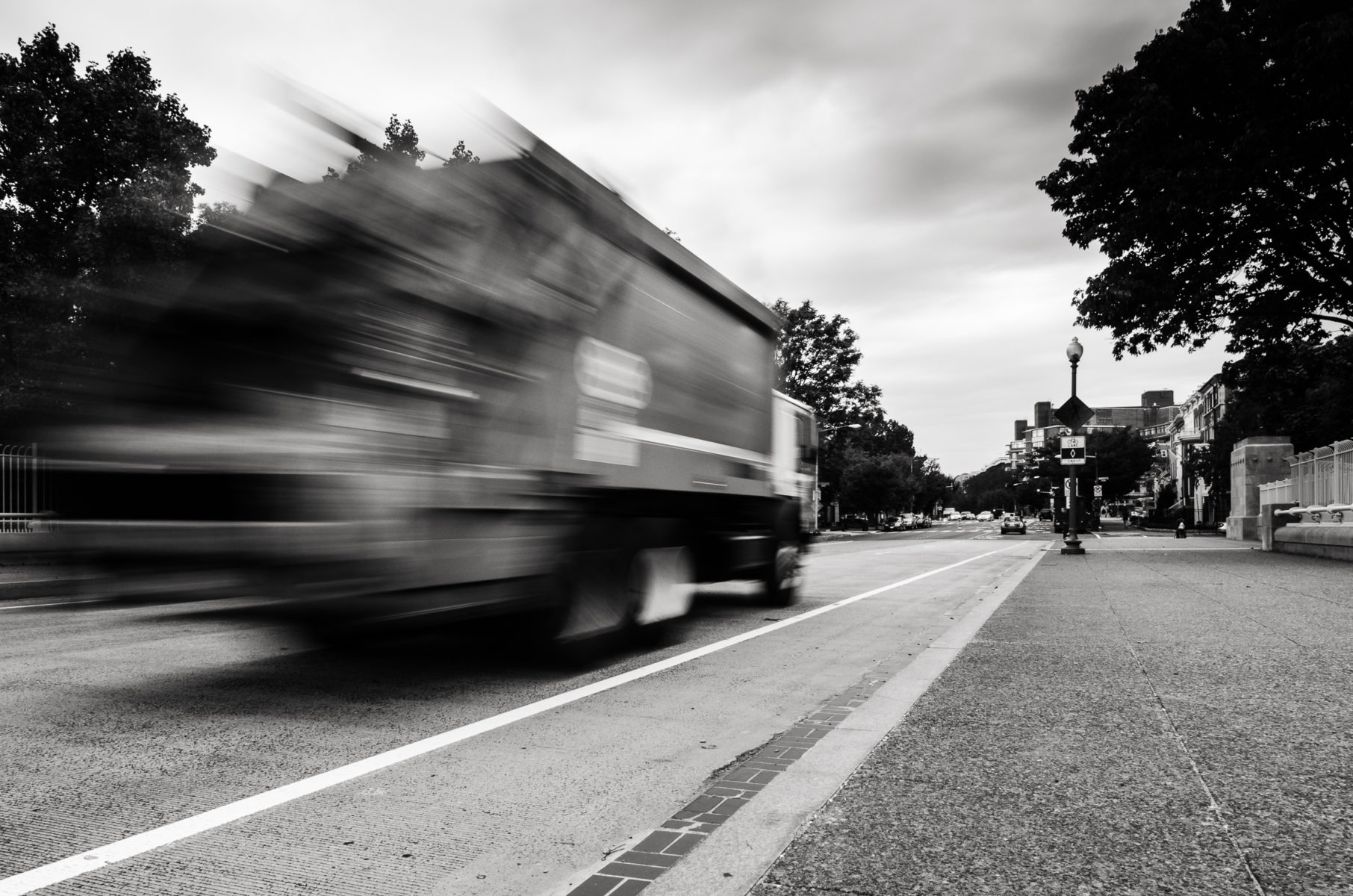 Garbage Truck racing past in Woodley Park DC