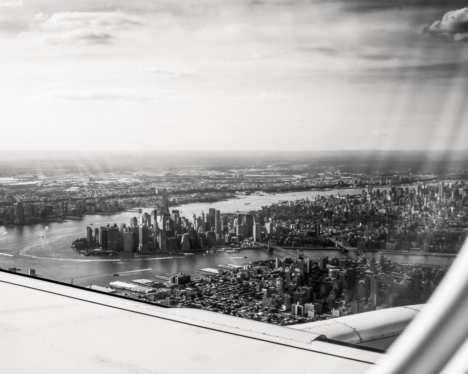 view of lower Manhattan from airplane window