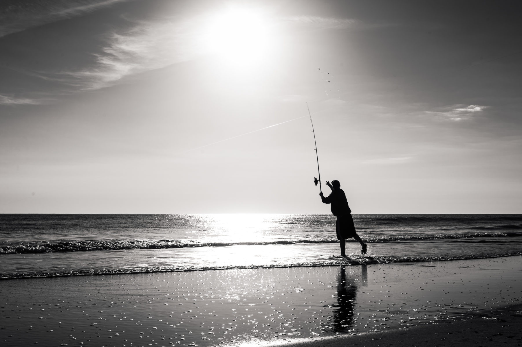 man fishing in the outer banks at sunrise