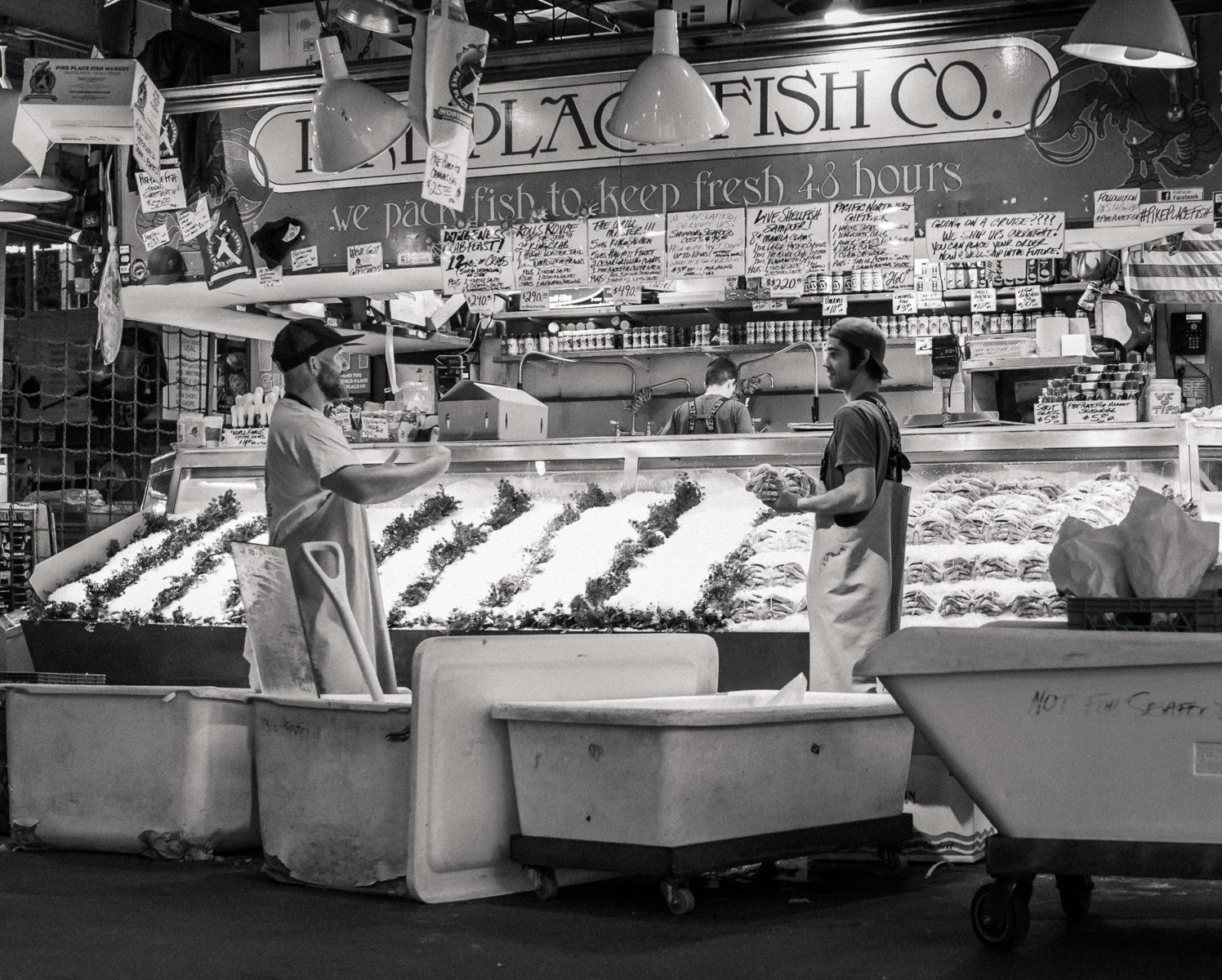 Workers at Pike Place Fish Market setting up in the morning