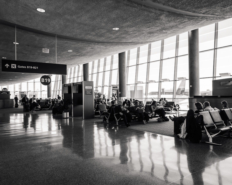 travelers at the gate in Boston Logan Airport