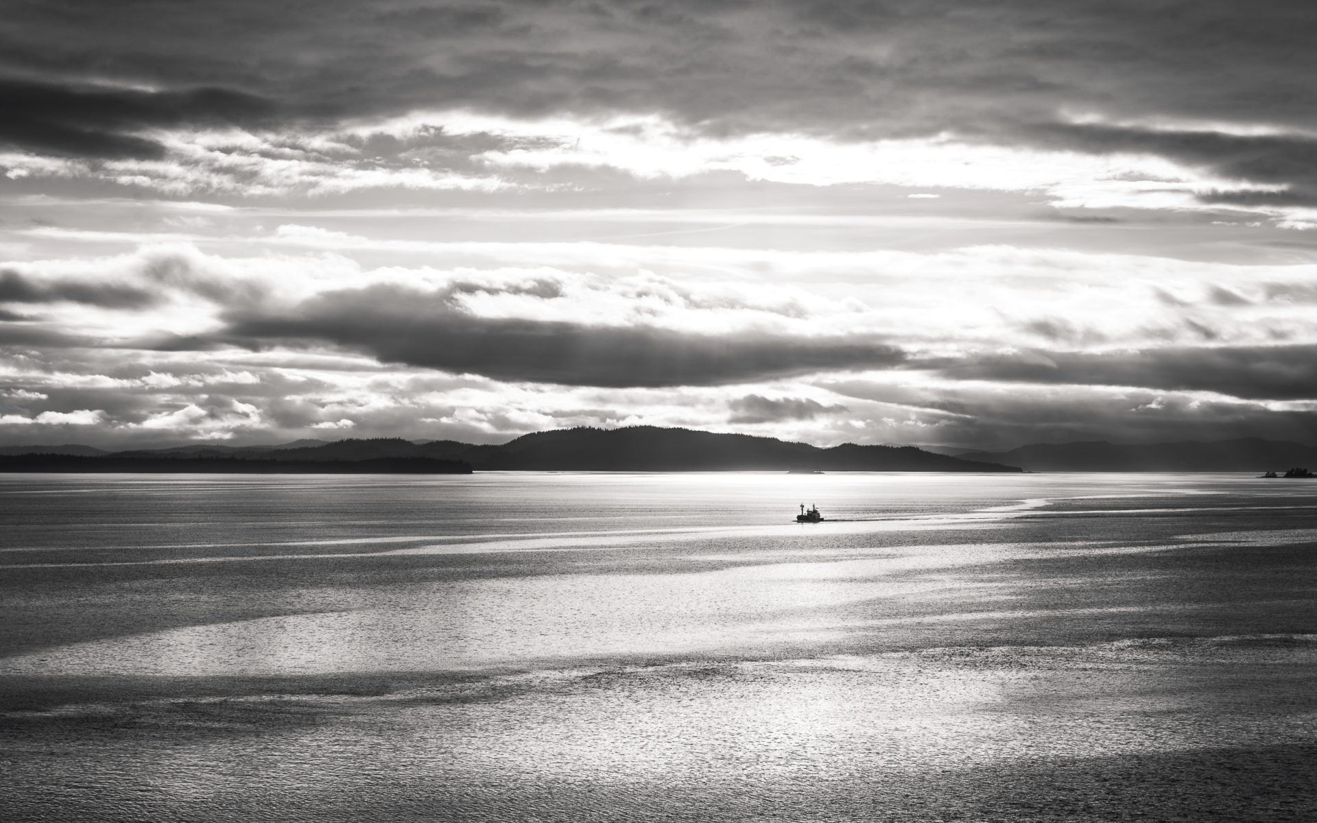 Alaskan fishing boat headed out at dawn