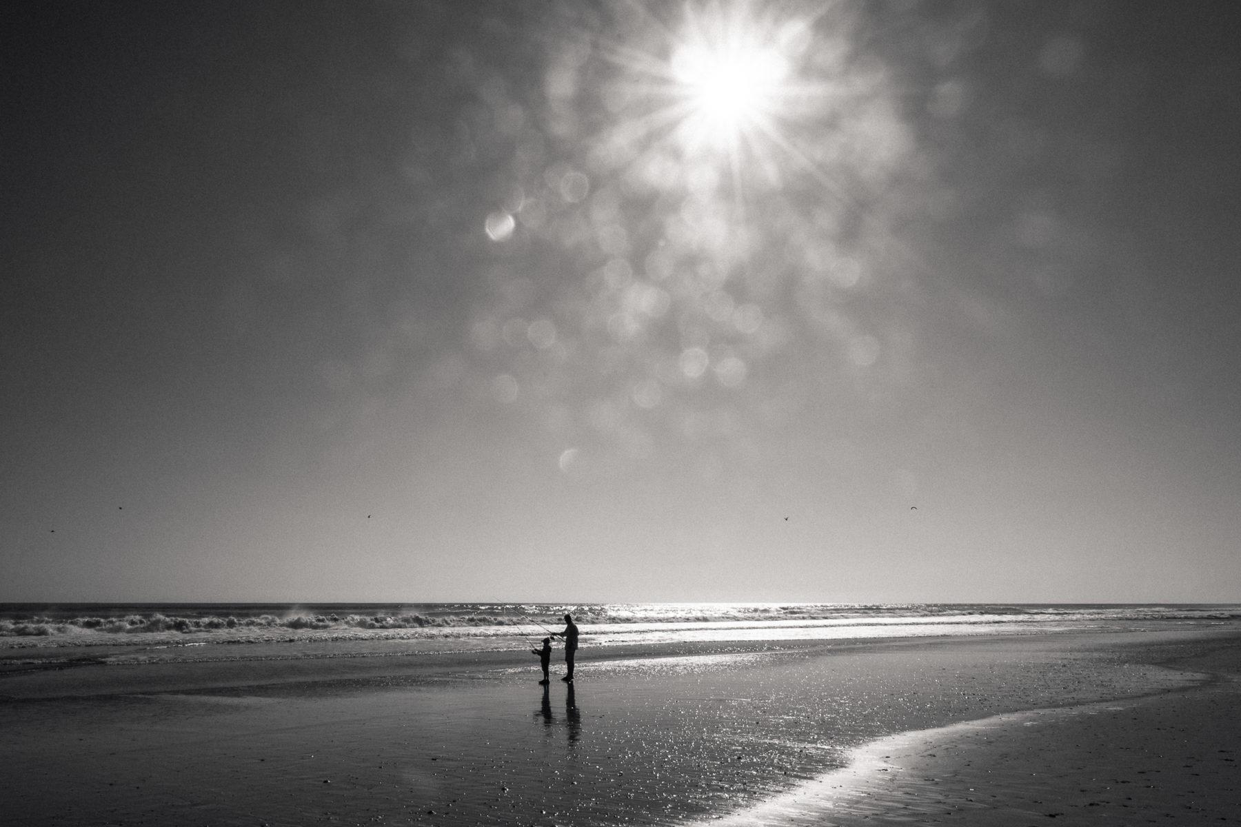 dad and son surf fishing at day break in Corolla North Carolina