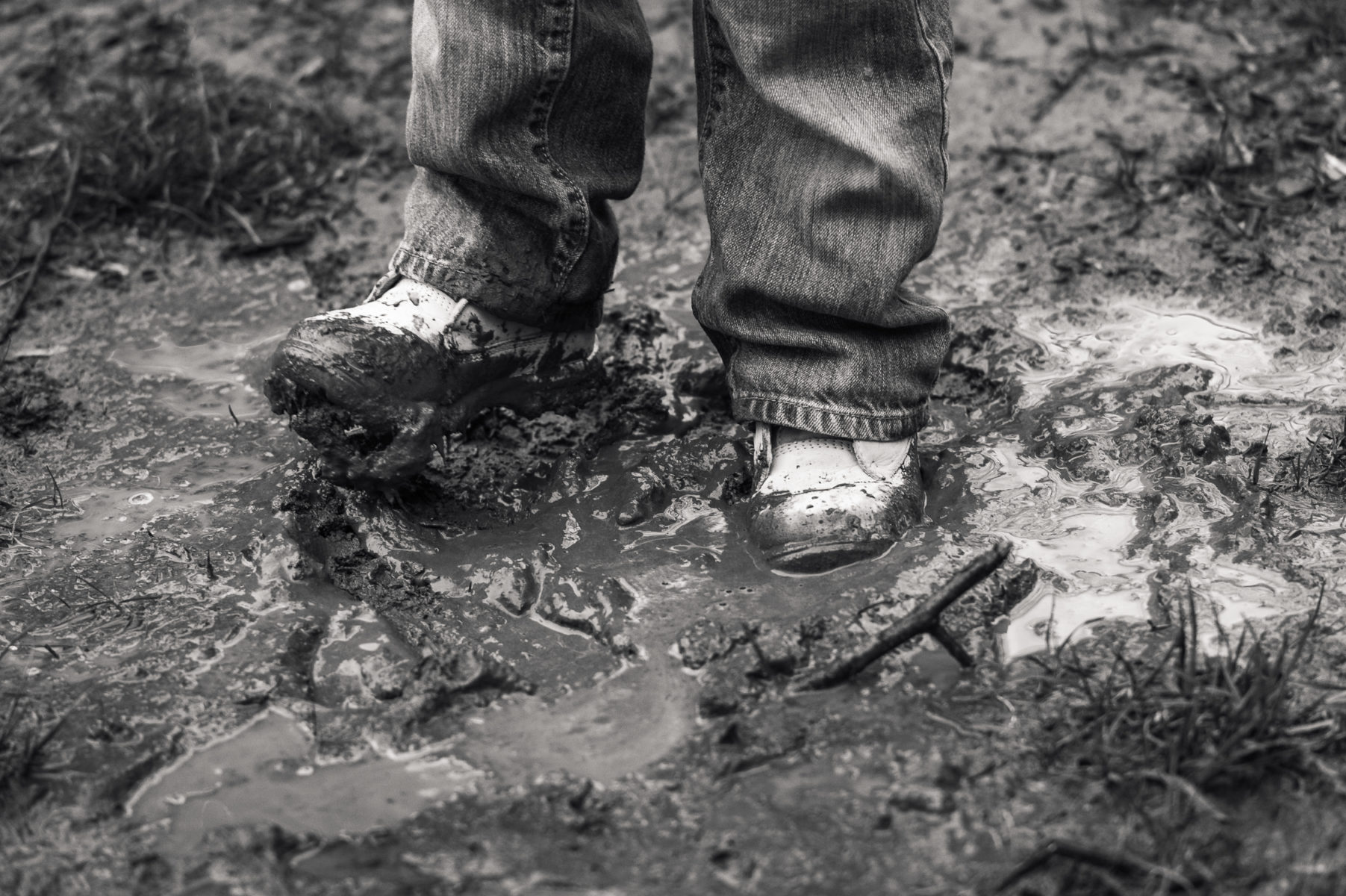 muddy boots in dirt