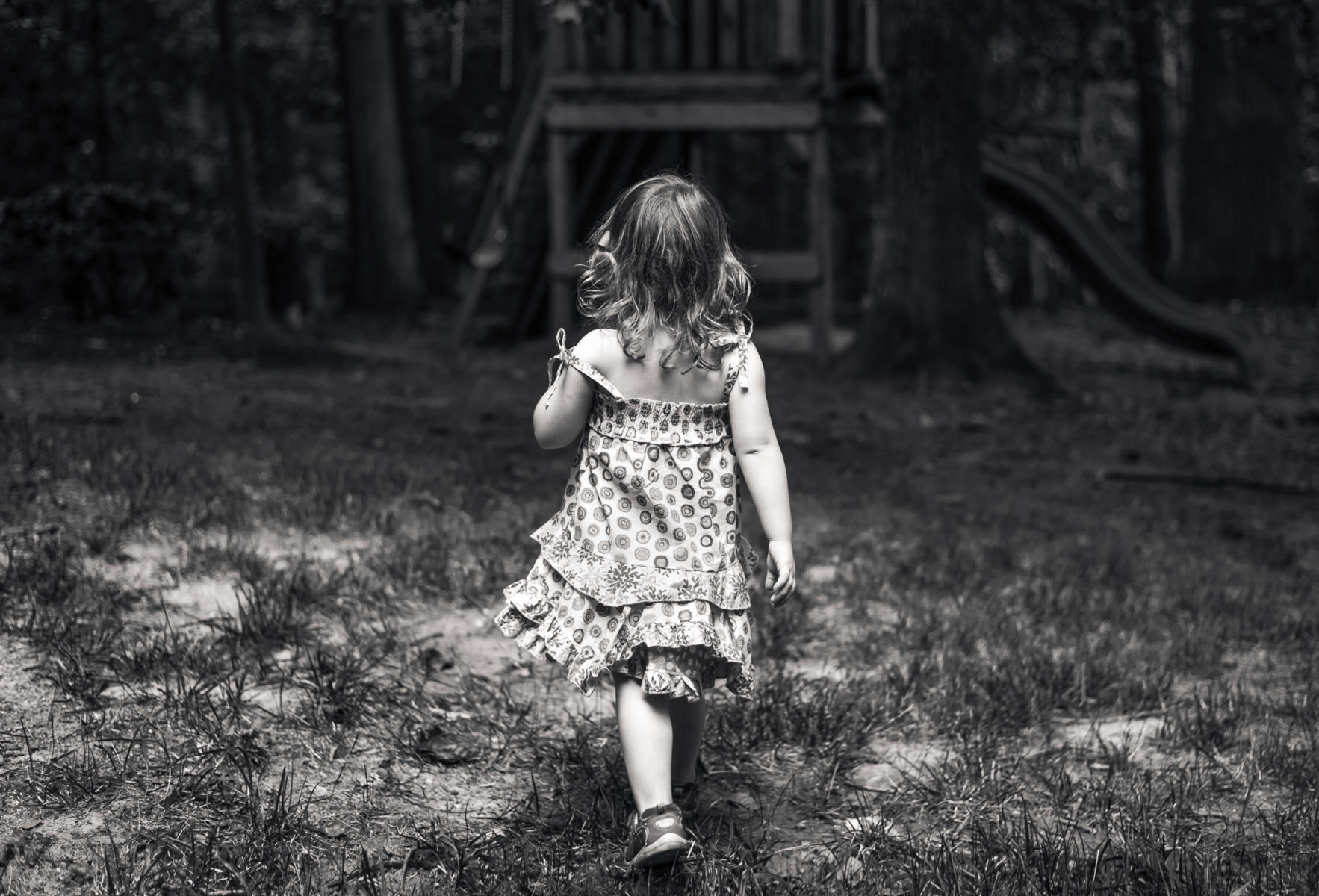 girl walking to playground in the woods